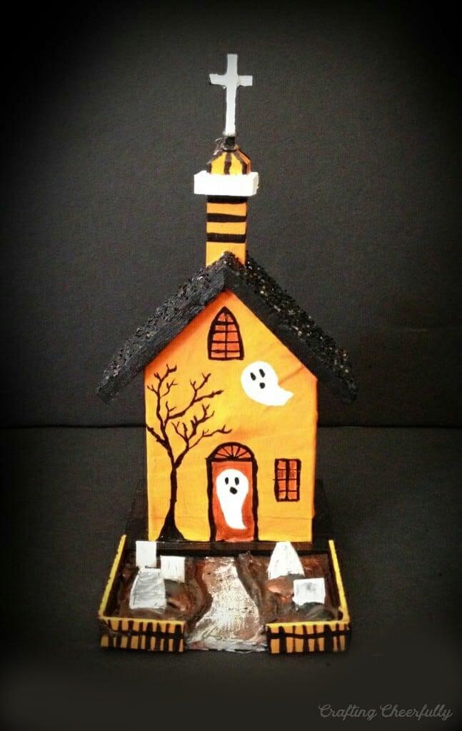 Haunted house painted orange and black.