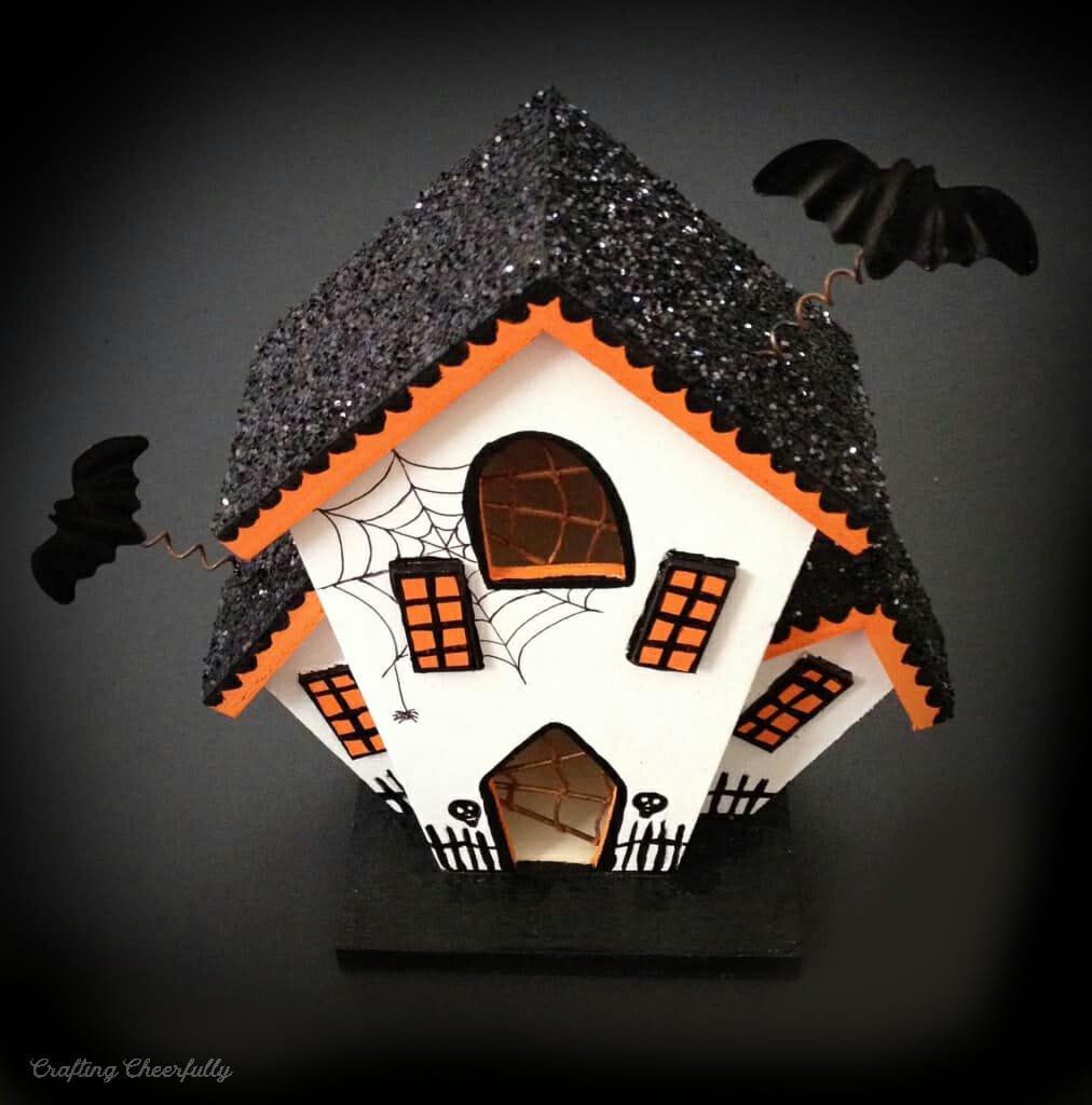 Haunted House painted orange, white and black.
