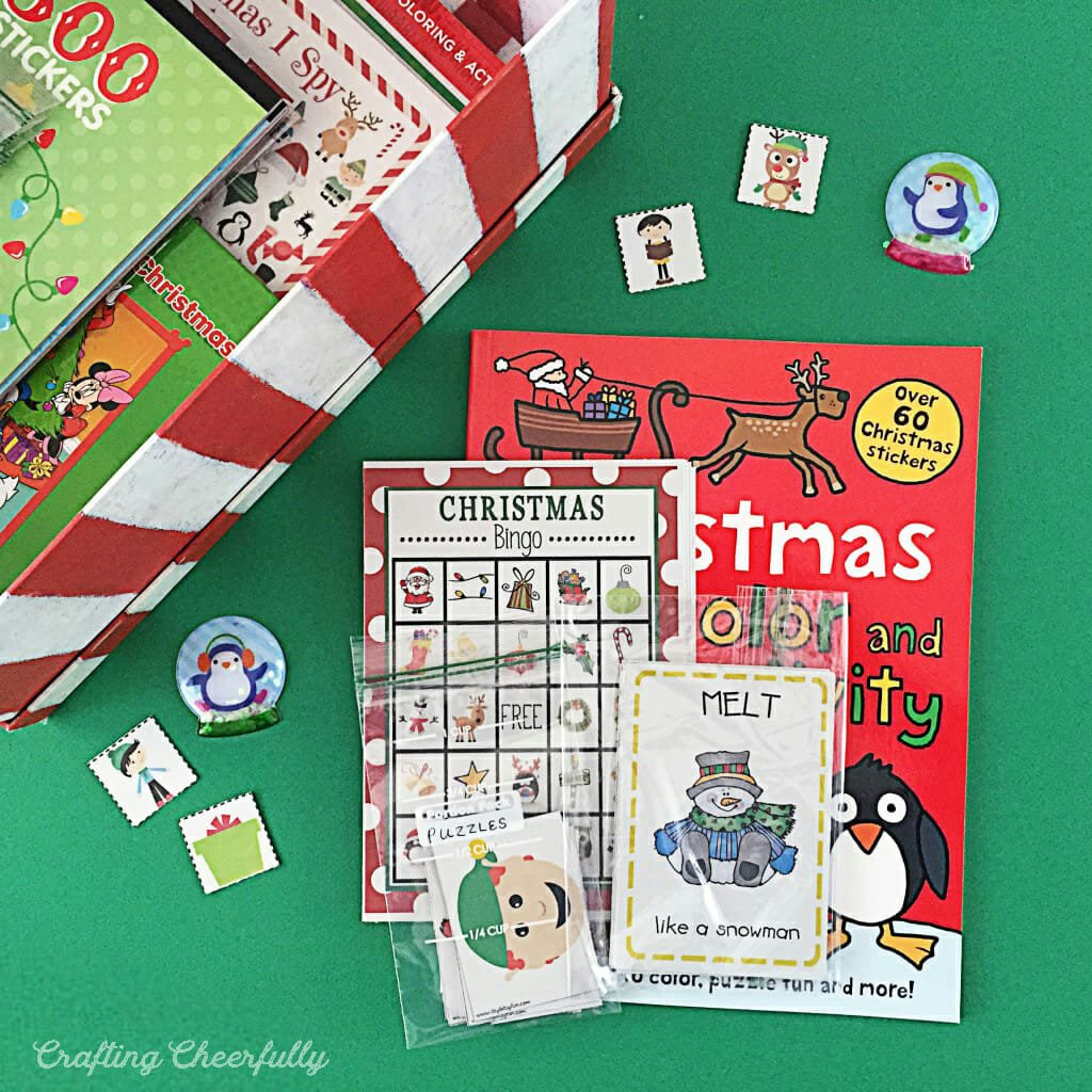 Box of toddler Christmas activities sits on a green table surface.