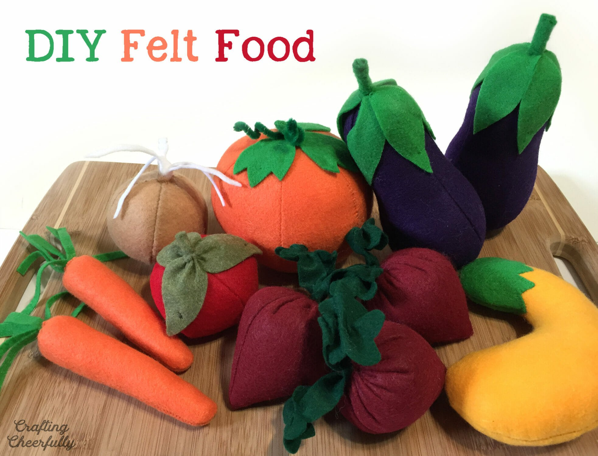 Handmade felt play food including vegetables, fruit, and bread.