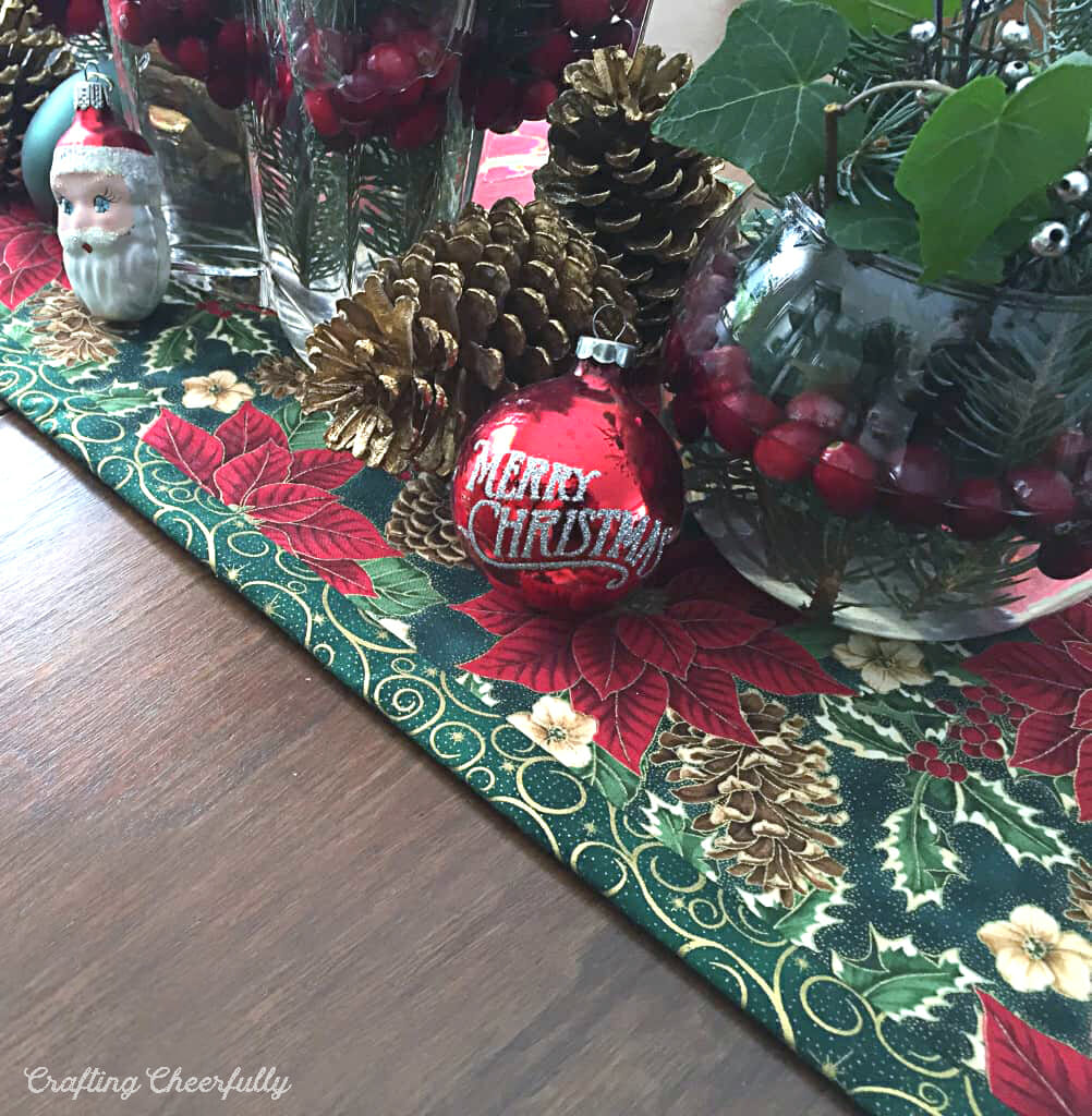 Holiday table runner in green and red fabric.