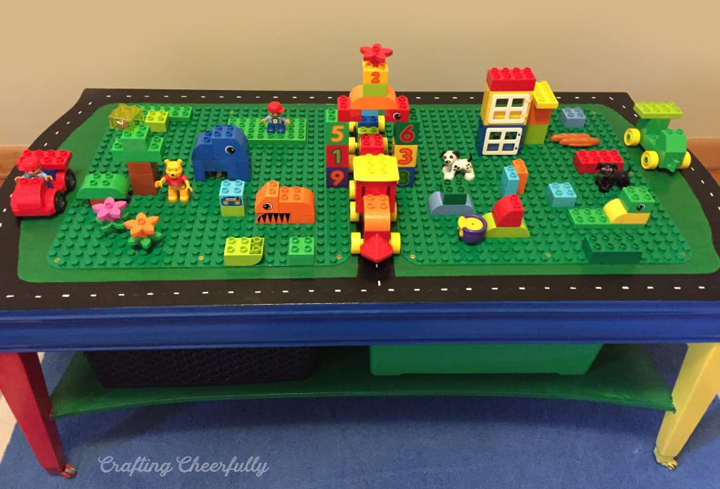 A handmade, and colorfully painted, LEGO and DUPLO table