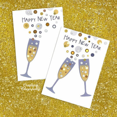 Happy new year cards featuring champagne glasses on a gold background.