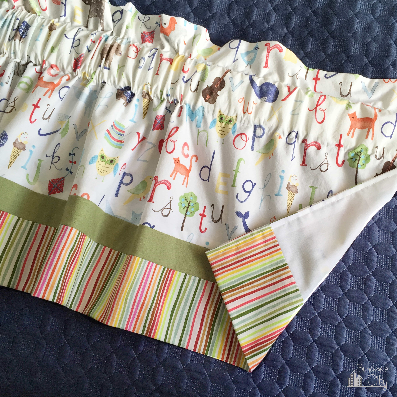 Nursery curtain valance made from a crib sheet.