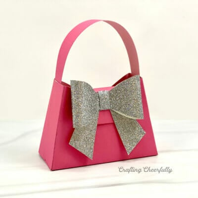 Paper pink purse with large silver sparkly bow!
