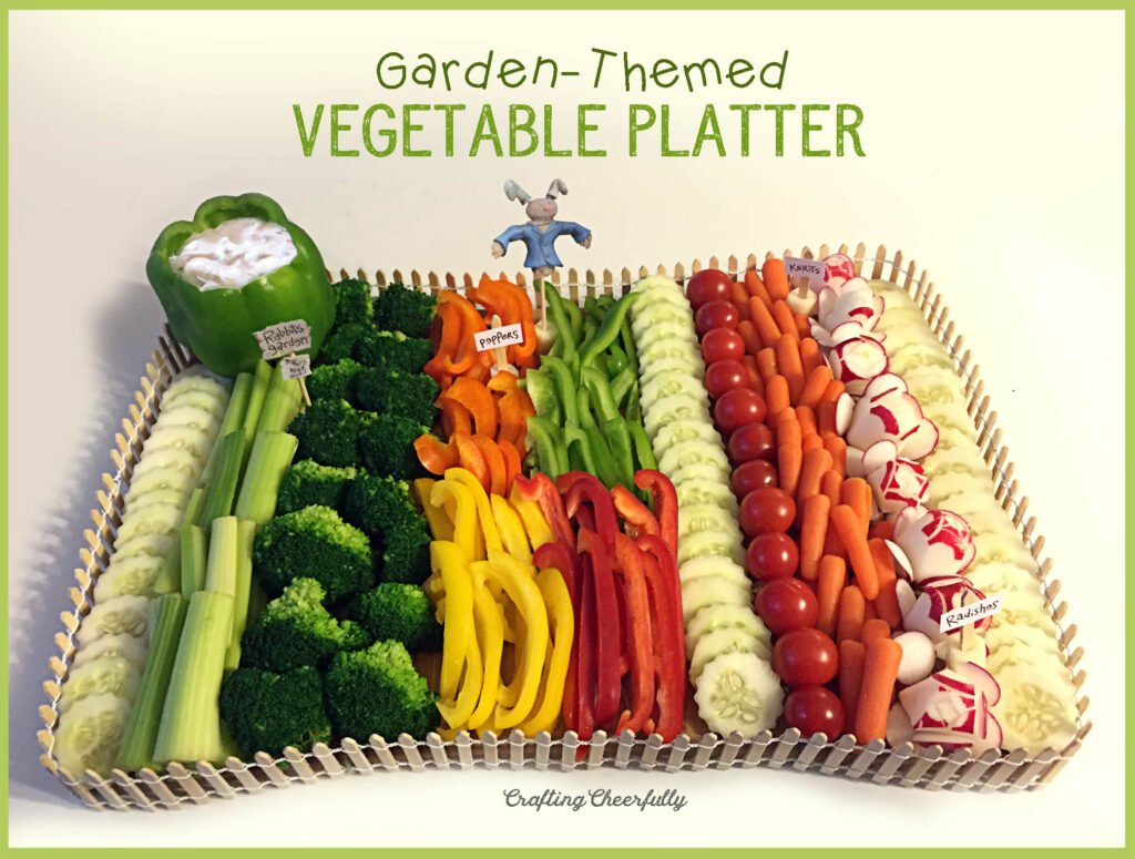 Garden-themed vegetable tray with a cute wooden fence around it and vegetable signs.