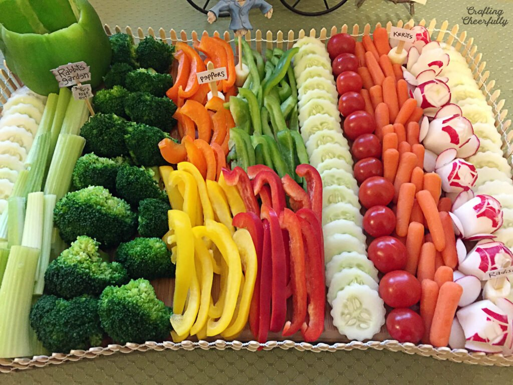 Vegetables are lined up in rows on a cutting board.