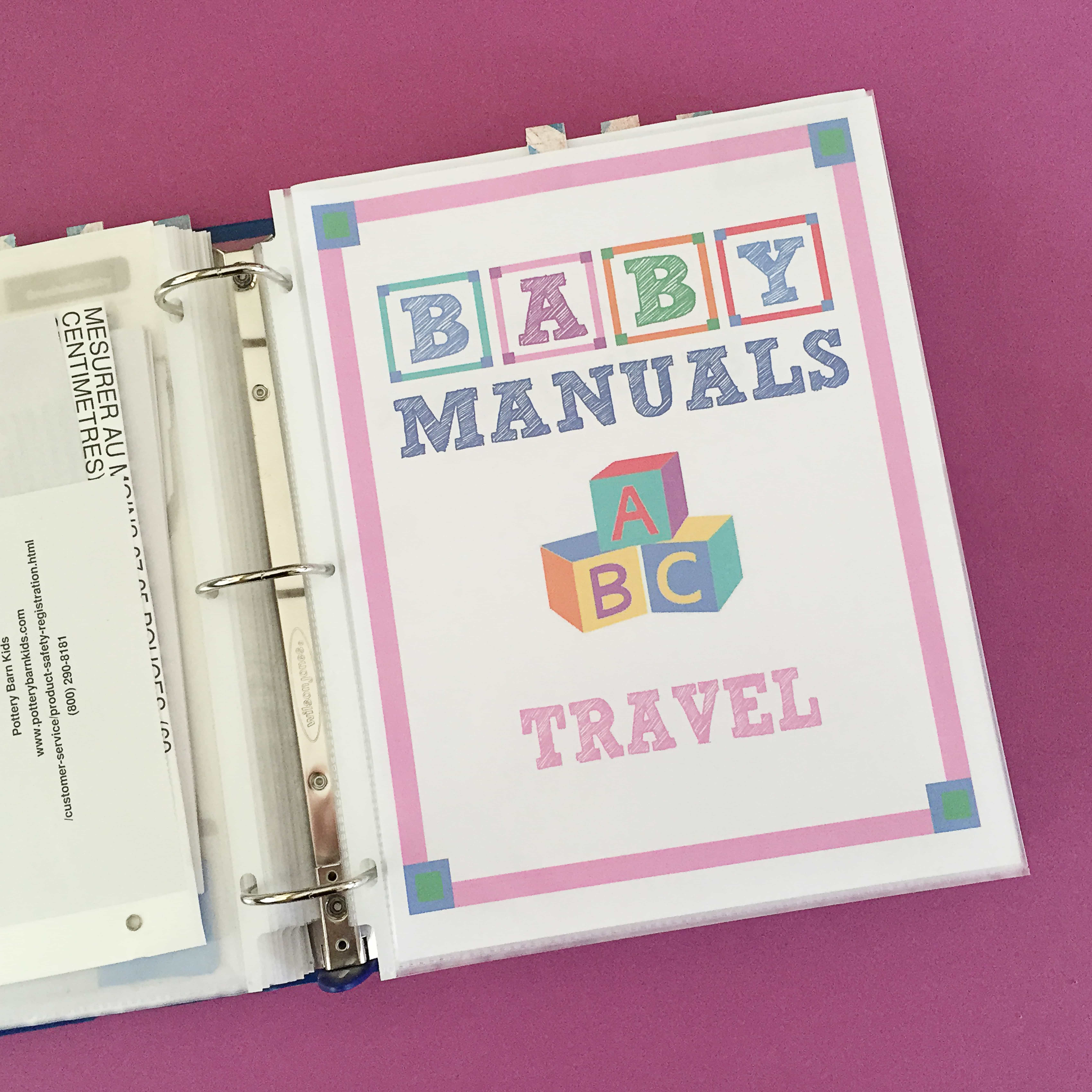 Binder is open to a page that says Baby Manuals Travel on a purple tabletop.
