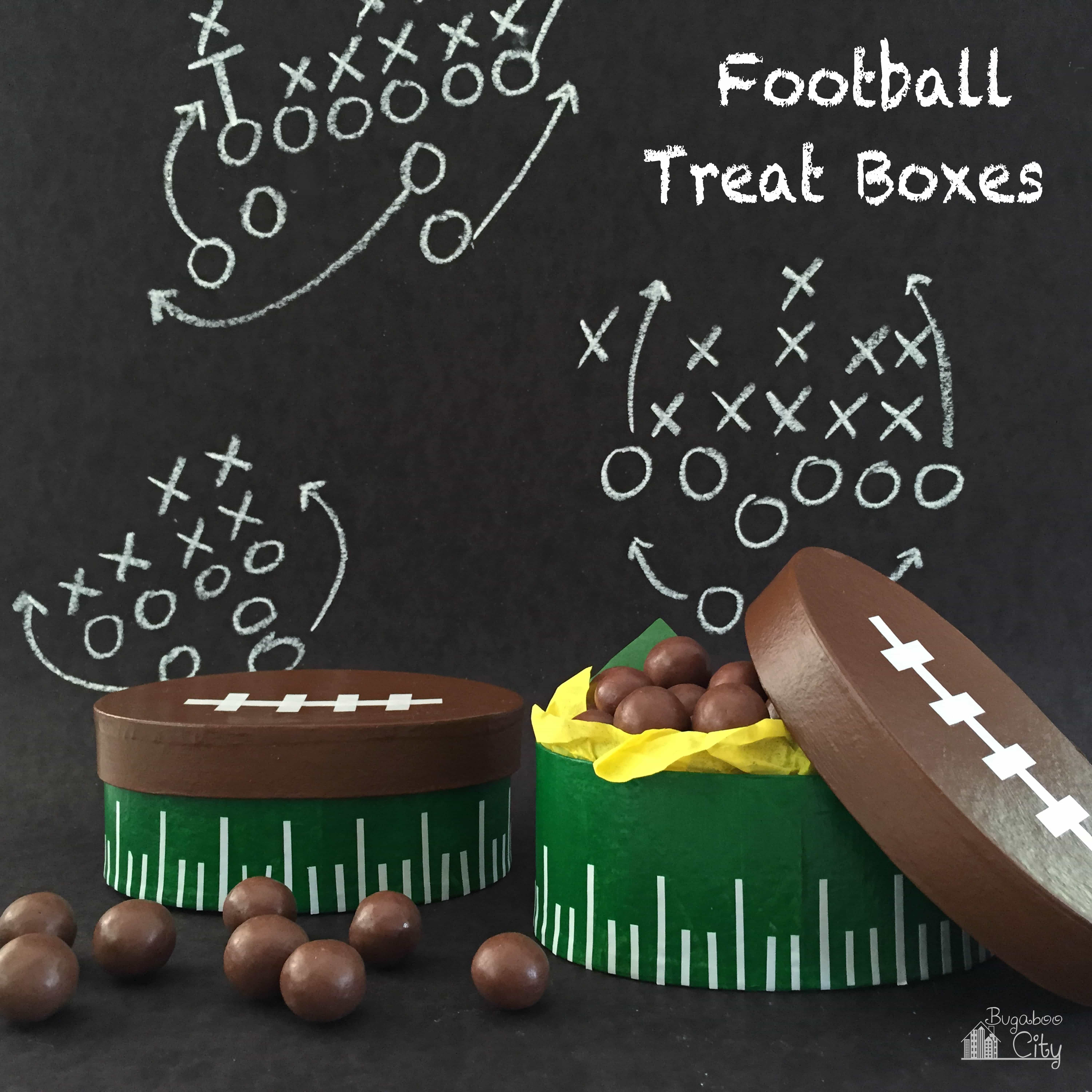 Football shaped treat boxes filled with chocolate malt bars in front of a back chalkboard with white football plays drawn on it.