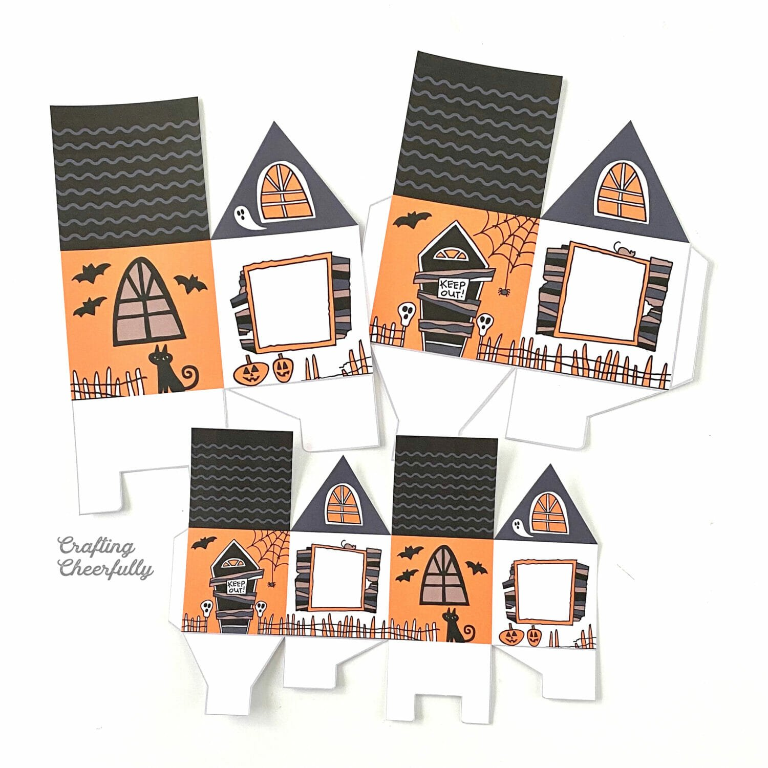 Haunted House treat boxes cut out lay on a white table