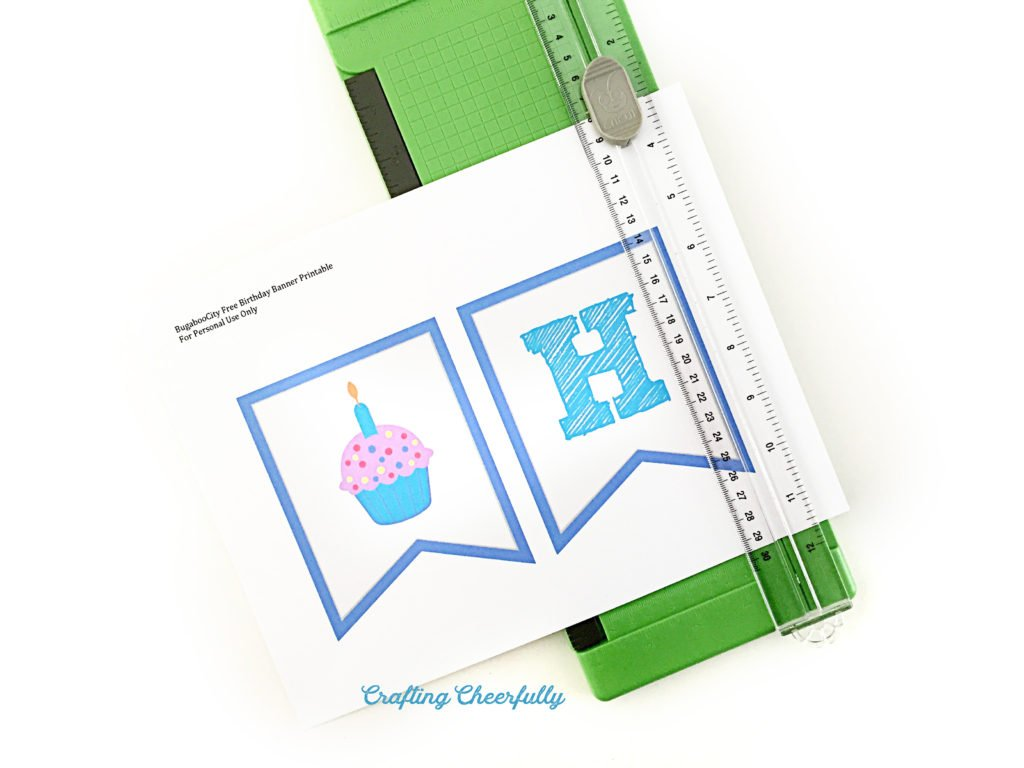 Banner printable pages are cut out with a paper trimmer.