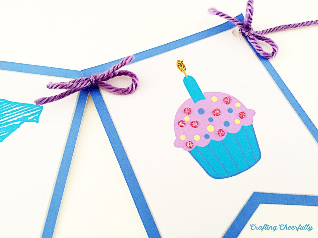 Close up of one of the birthday banner pennants with a cupcake on it.