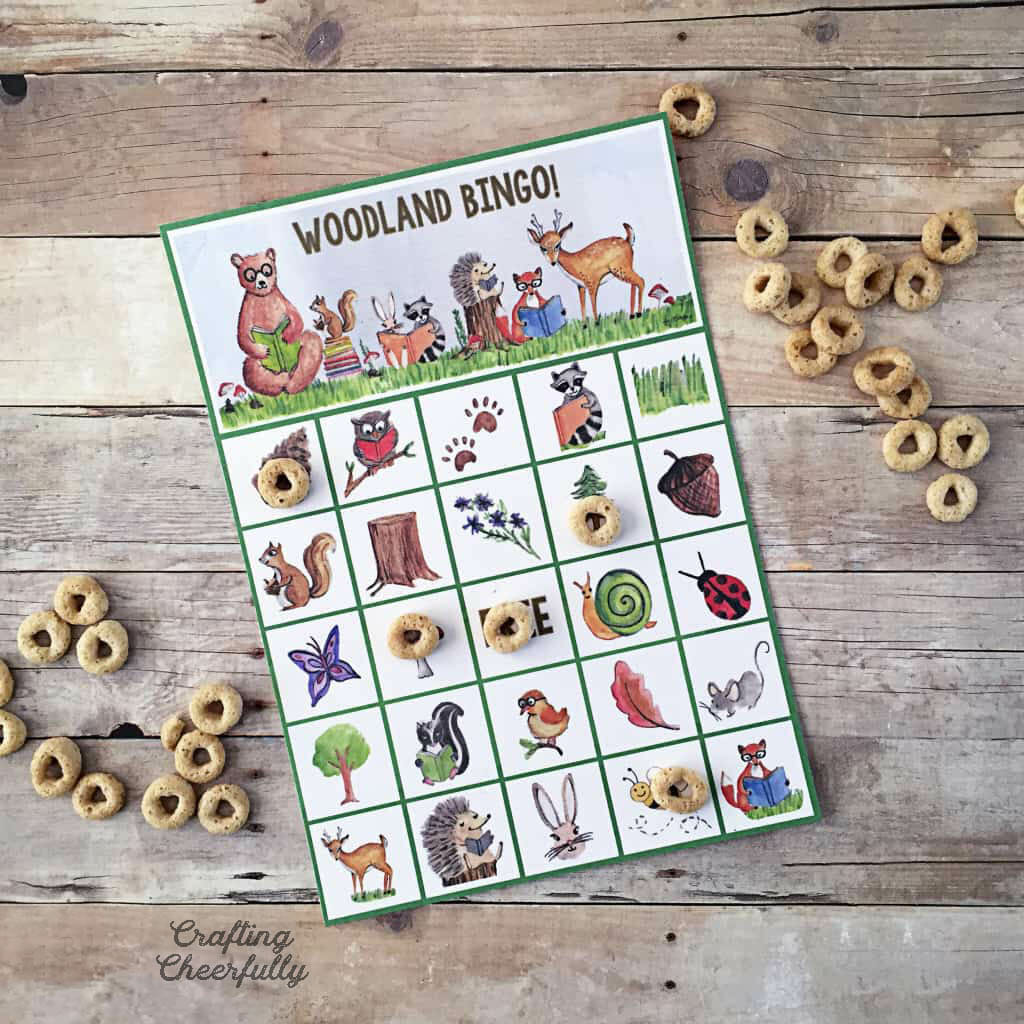 Woodland BINGO printable game with cereal markers.