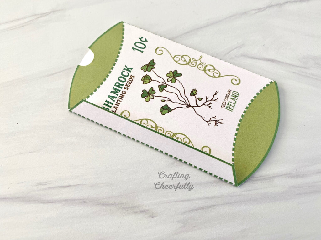 The tab on the printable shamrock box is folded to over.