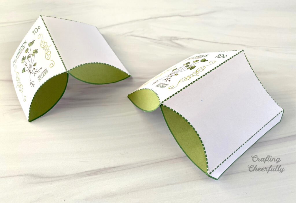 Two Shamrock pillow boxes are folded along their fold lines.
