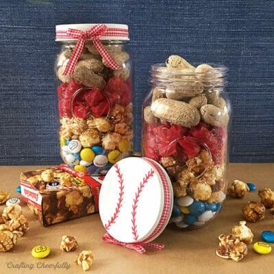 Mason jars filled with ballpark treats with a baseball lid.