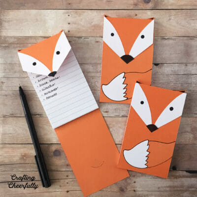 DIY Fox Notepads on a wooden table.