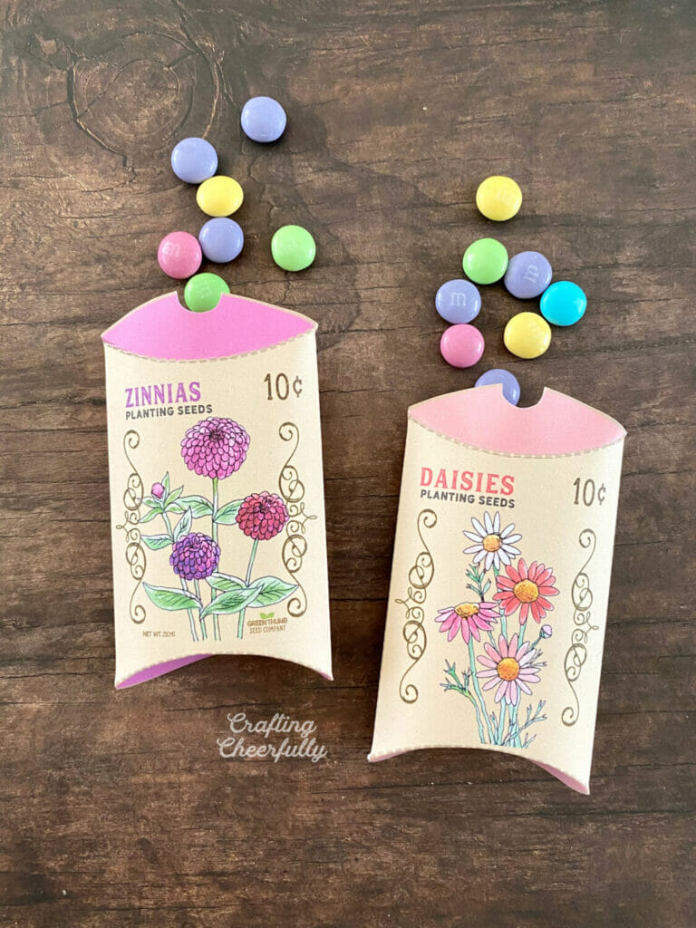 Flower seed pillow boxes filled with sweet candy.