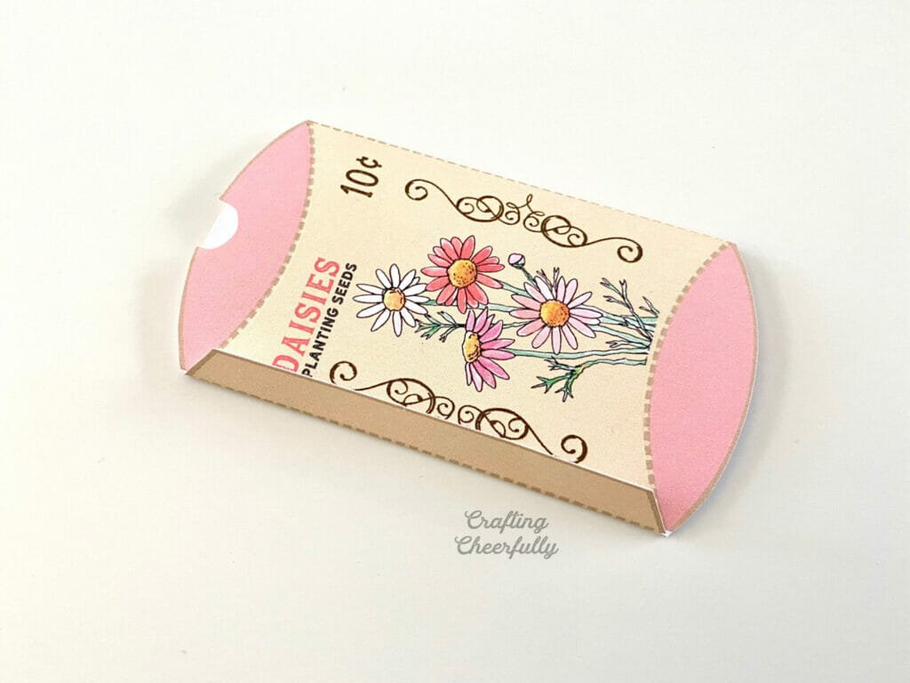 Flower seed box folded and laying on a white surface.