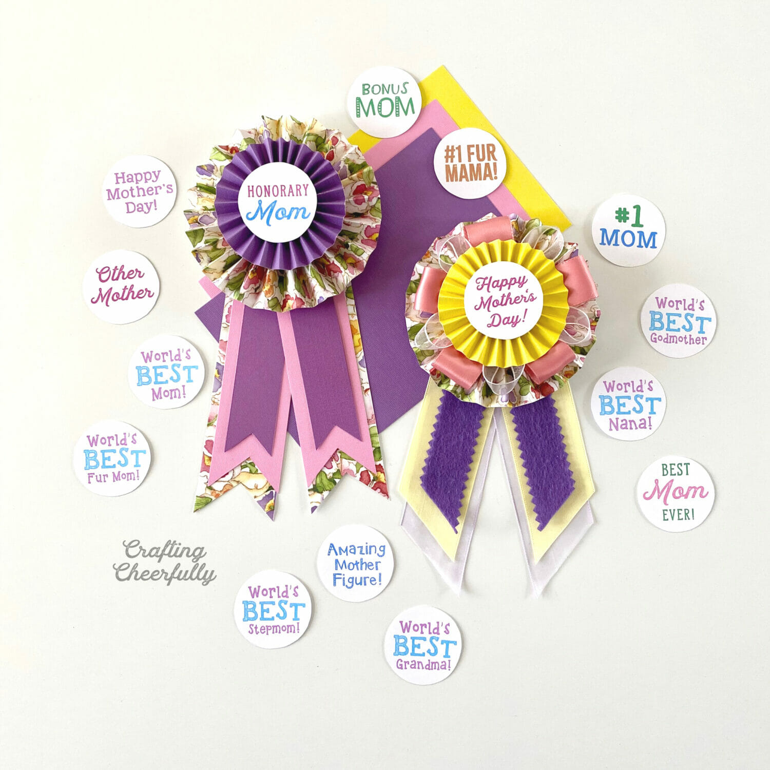Mother's Day paper medallion pins lay on a table with lots of different labels laying around them.