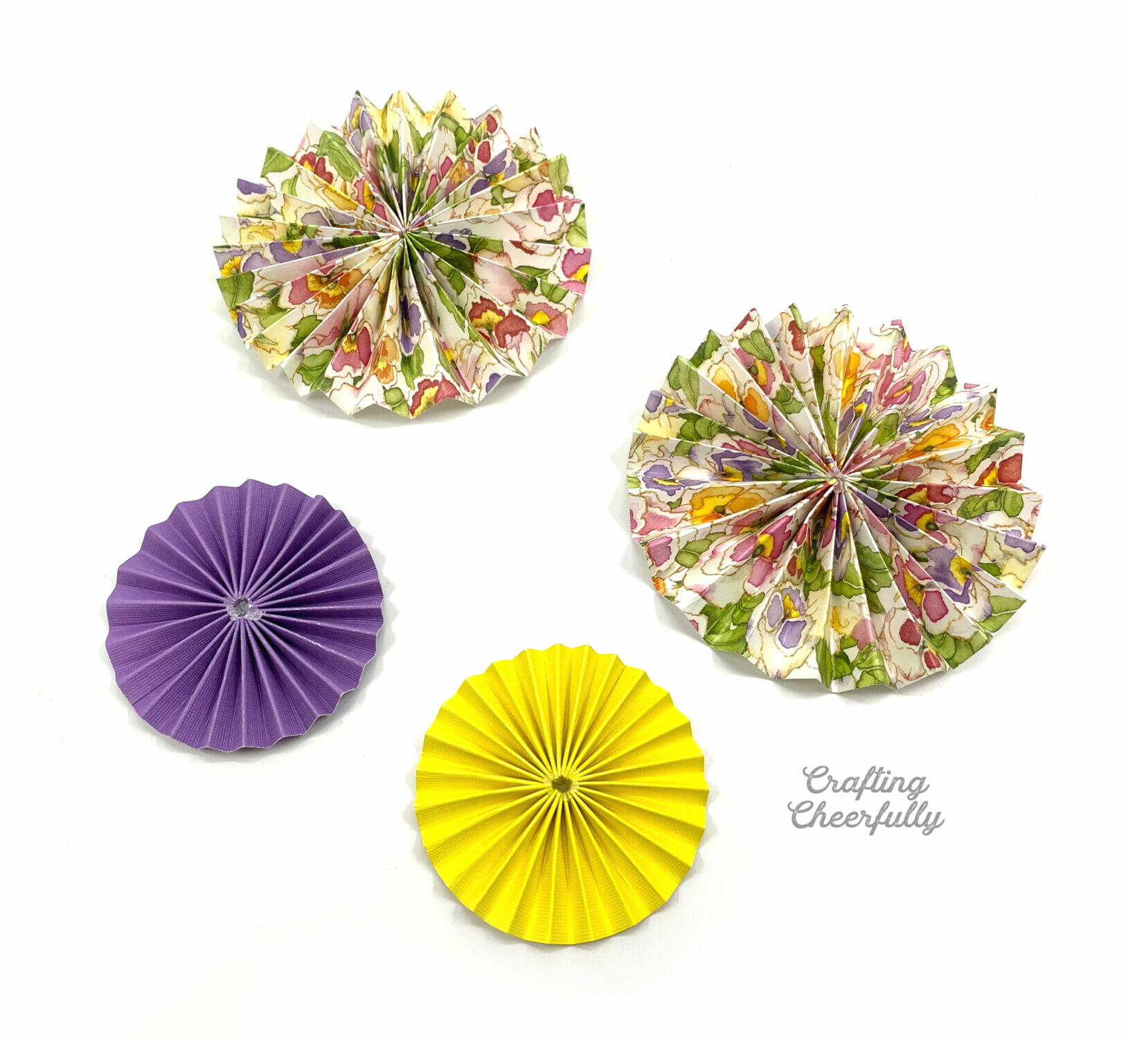 Paper rosettes lay on a white surface.