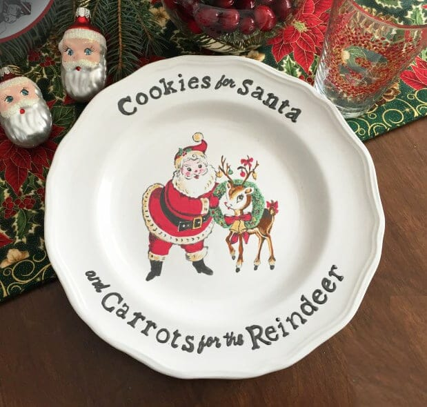 "White plate with Santa and Rudolph painted in the center and the words ""Cookies for Santa and Carrots for the Reindeer"" around the edges."
