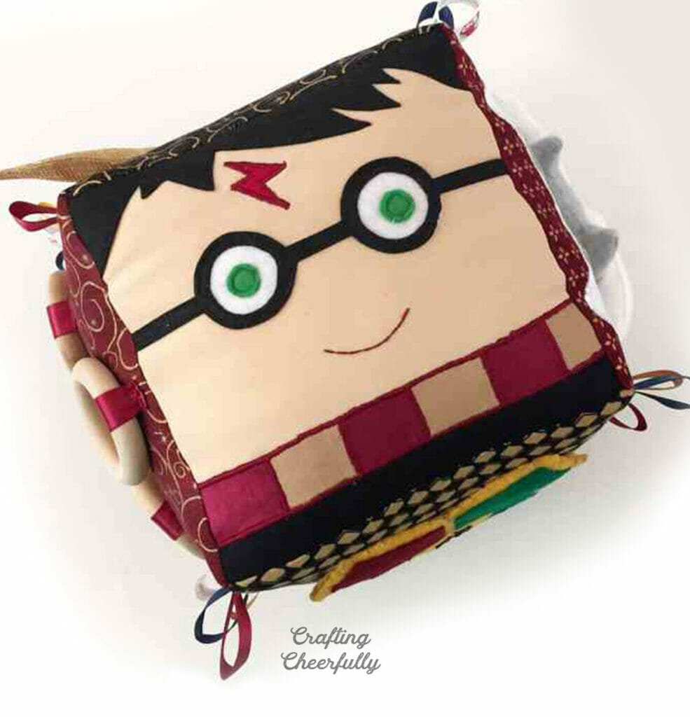 Top of the fabric activity cube showing Harry Potter's face.