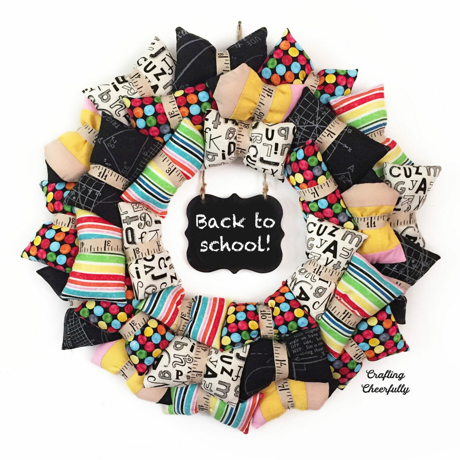 Back to School pillow wreath wth fun colorful fabrics including tiny pencil pillows!