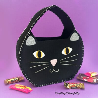 Black felt cat treat bag for holding candy on Halloween.