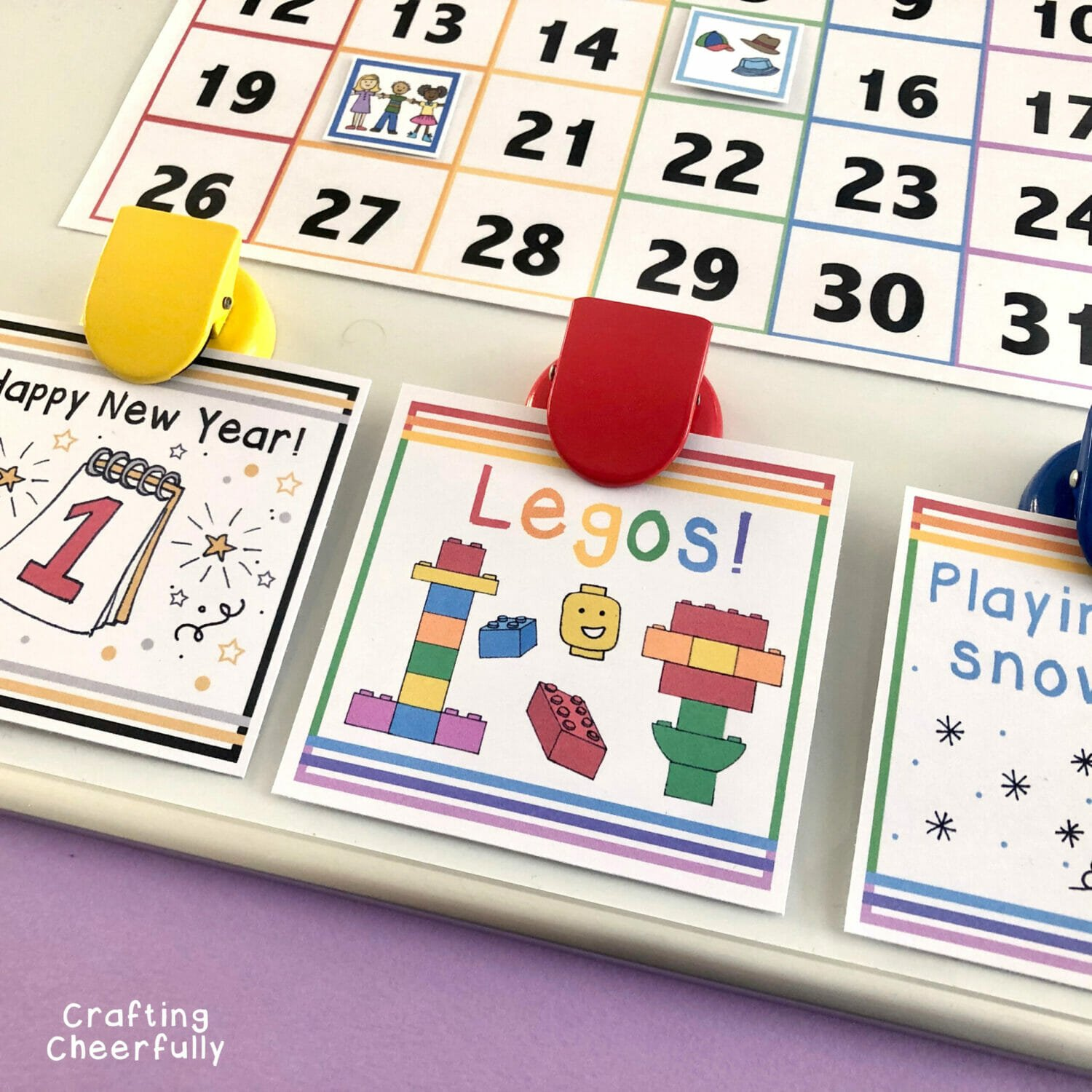 Activity cards clipped to kid's calendar.