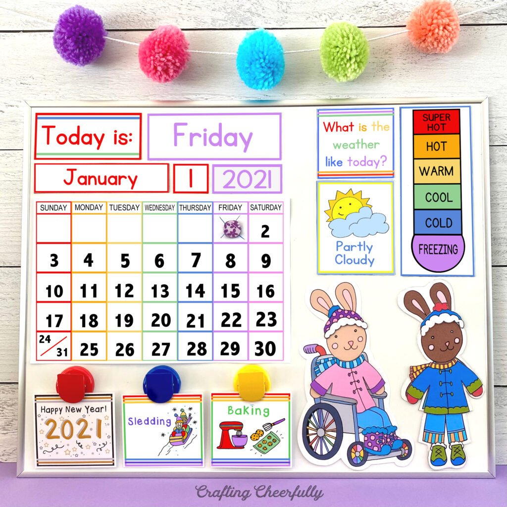 Colorful DIY Children's Calendar on a white board with a pop pom banner hanging above it.