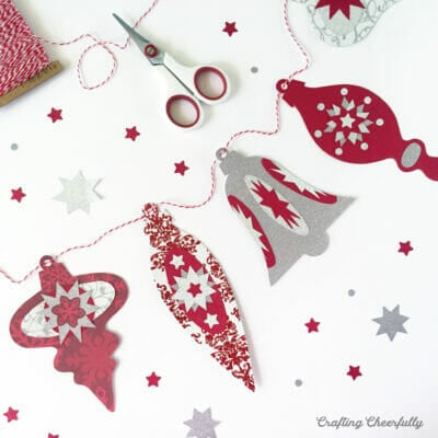 Red, white and silver paper ornament banner inspired by vintage ornaments.