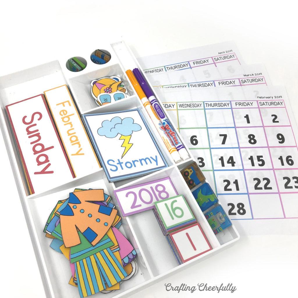 Children's calendar printable magnets stored in a white storage container.