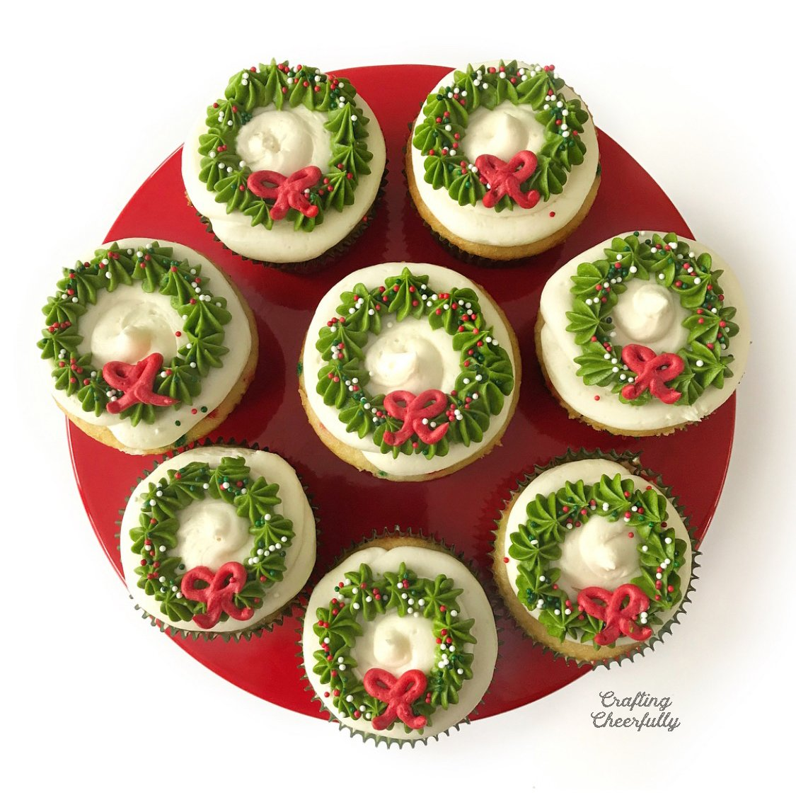 Cupcakes with frosting wreath designs on the top.