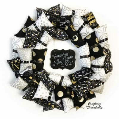 Happy New Year wreath in silver, gold, black and white fabrics.