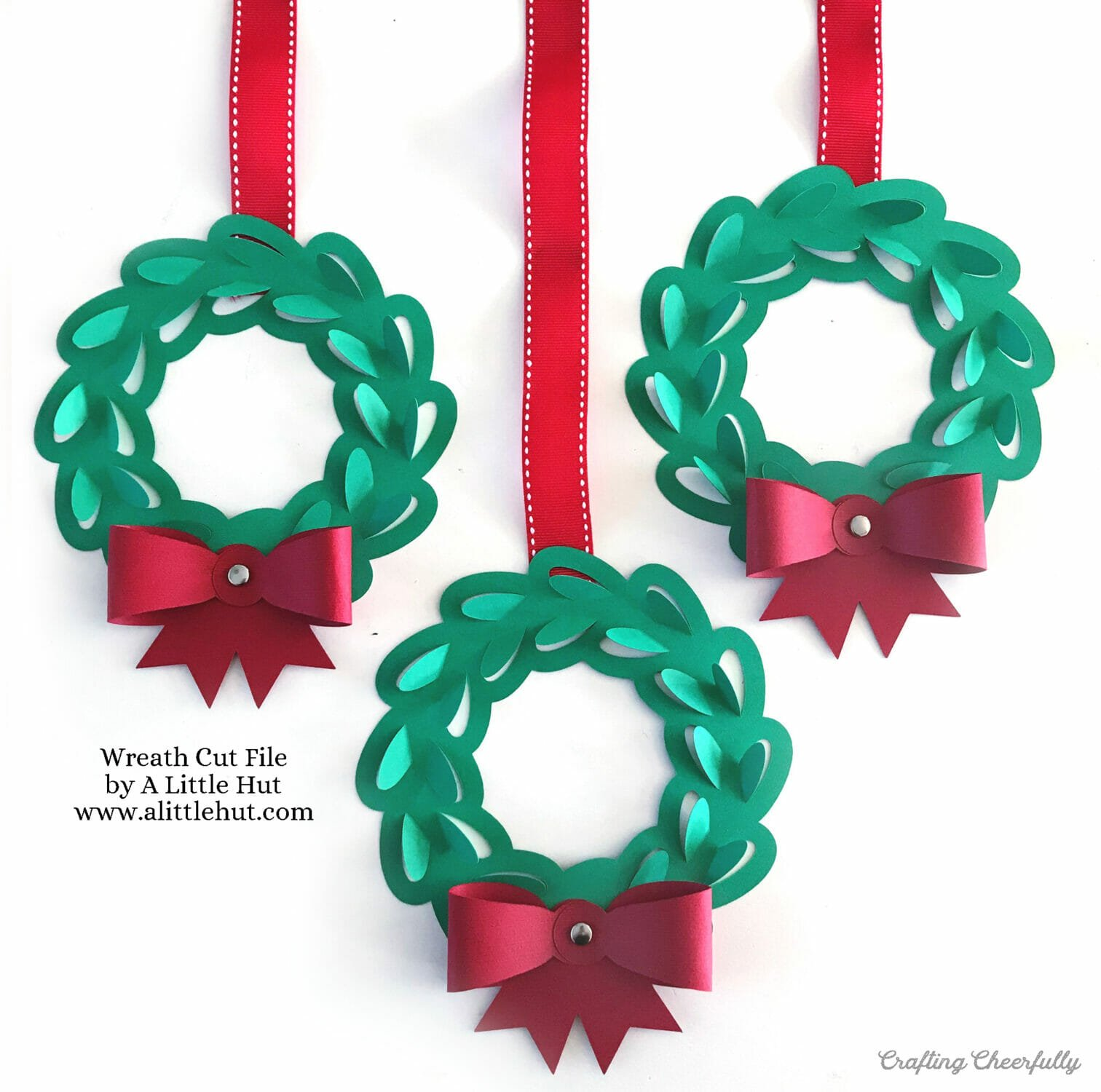 Three holiday wreaths made out of paper using a cut file by A Little Hut