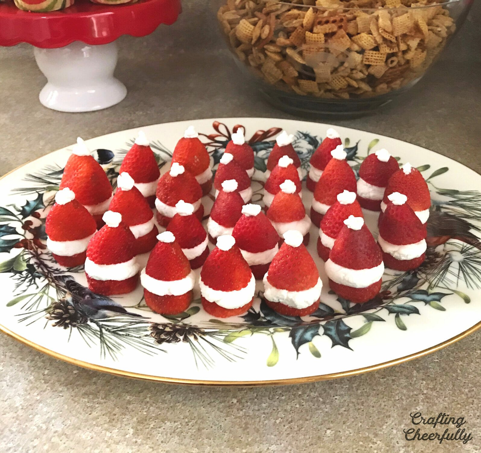 Strawberry santa hats made with strawberries and whip cream.