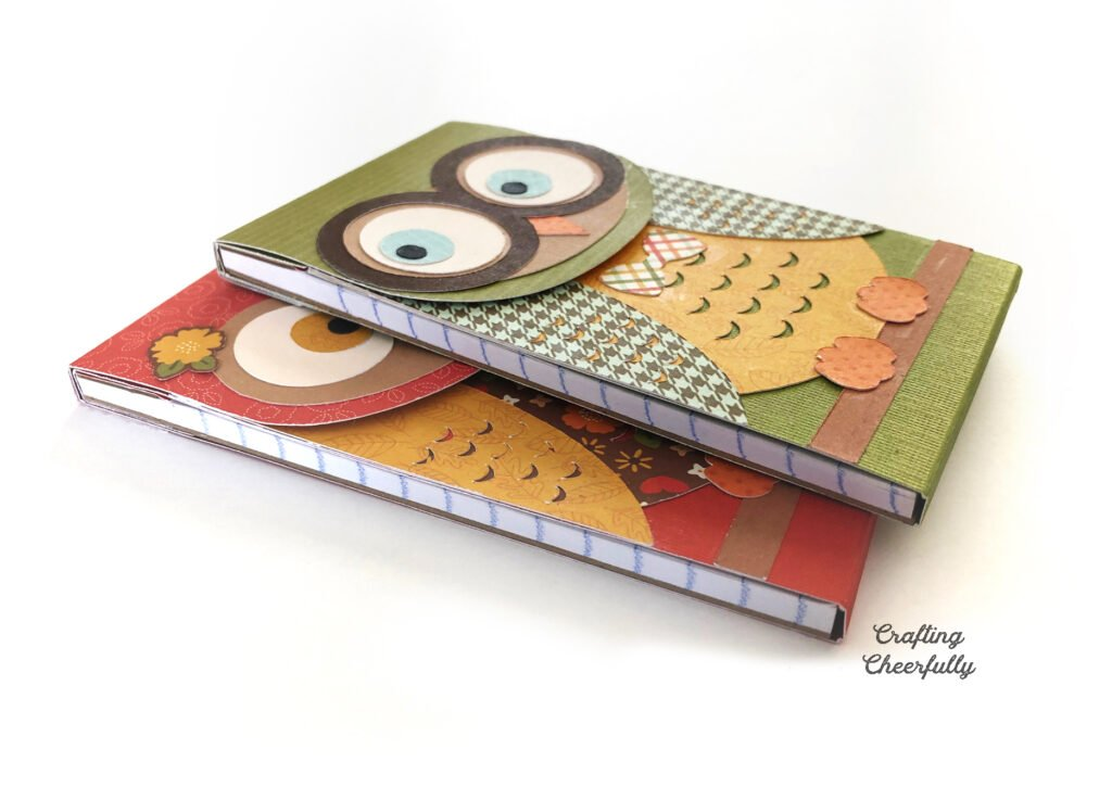 Two owl notepads laying on a white table.