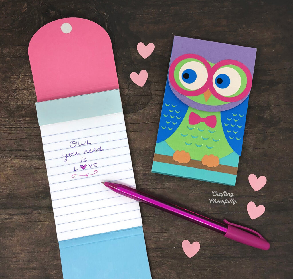 """Owl notepads. One is open with the words """"Owl You Need is Love"""" written inside."""