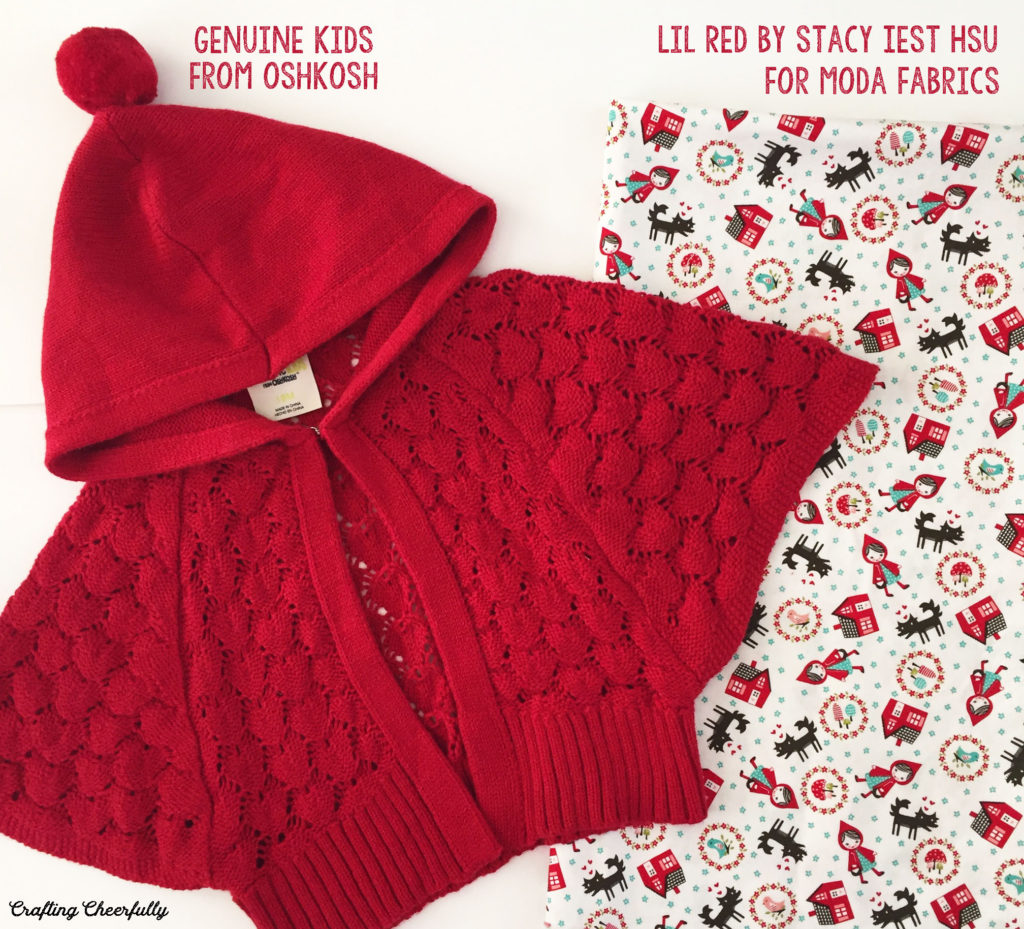 Little Red Riding Hood baby dress fabric Lil Red by Stacy Iest Hsu lays next to a little red cape.