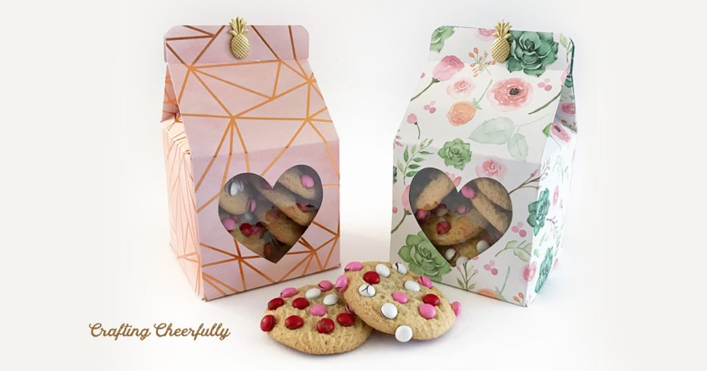Valentine's Day Treat boxes in pastel colors filled with m&m cookies.