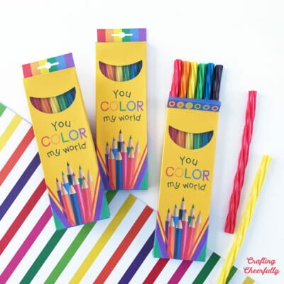 Colored pencil paper treat boxes hold colorful pieces of licorice!