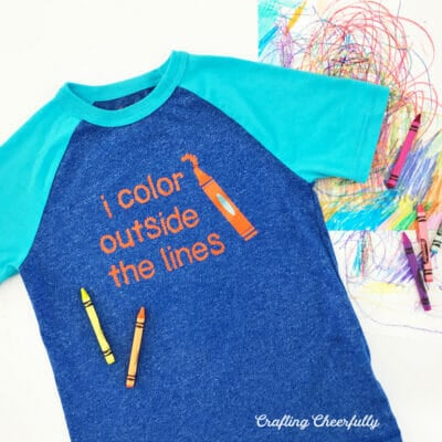 "Blue henley shirt with the words ""I color outside the lines"" in orange Iron-On."