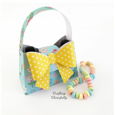 Blue floral paper purse box with giant yellow bow.