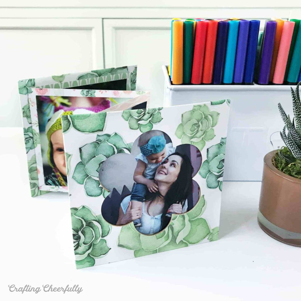 Accordion photo album made with floral paper for Mother's Day sits on a desk.