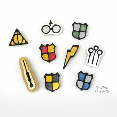 Harry potter magnets made with black glue lay on a white table.