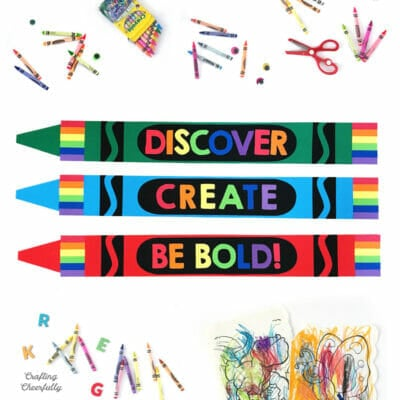 Colorful giant crayons made from paper with the words Discover, Create and Be Bold.