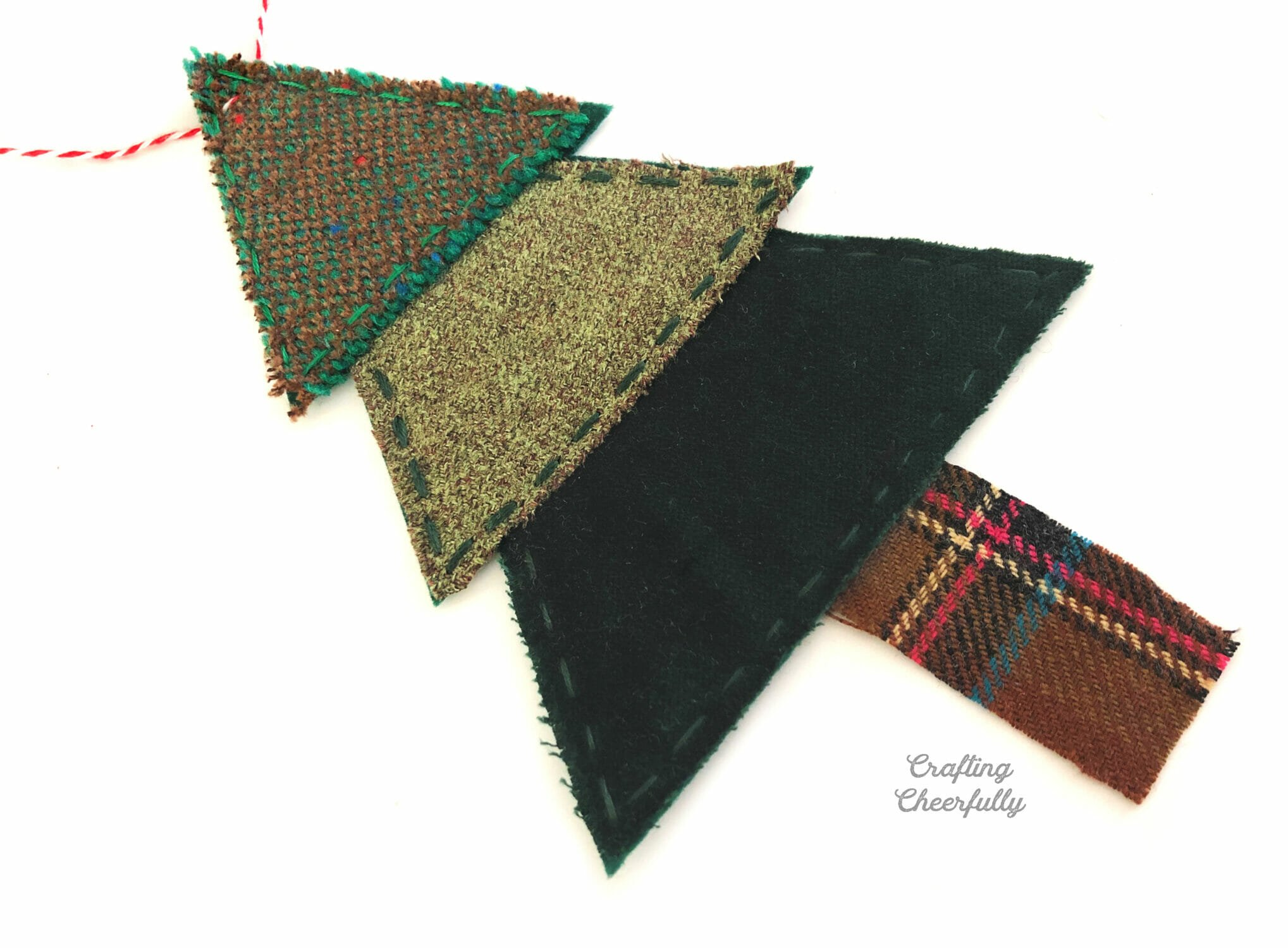 Christmas tree banner pennant made from scraps of green wood and brown wool for the trunk.