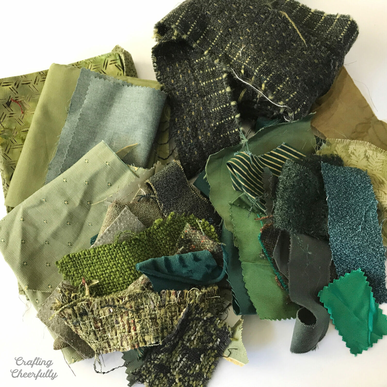 Green fabric scraps to make a holiday banner.