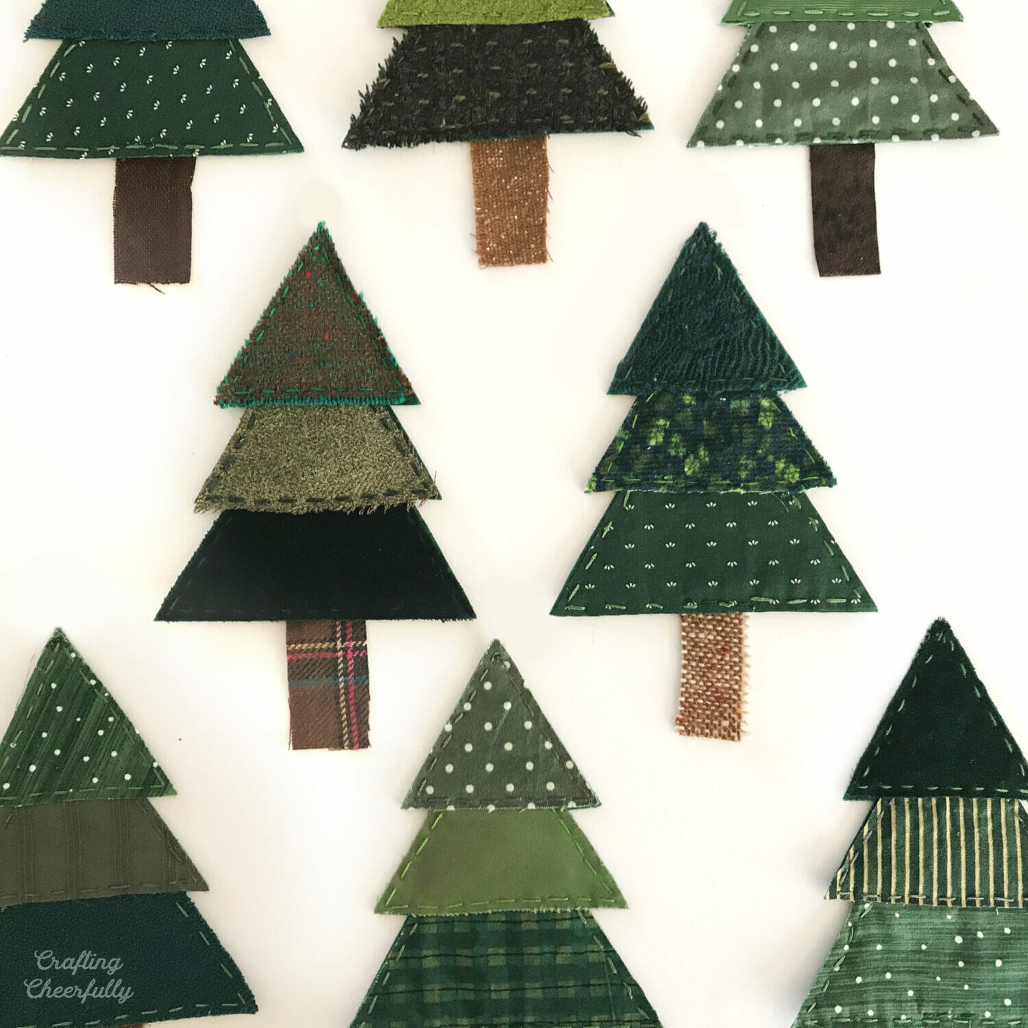 Christmas tree banner made with fabric scraps and felt.